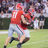Jake Fromm (11) hands-off to D'Andre Swift