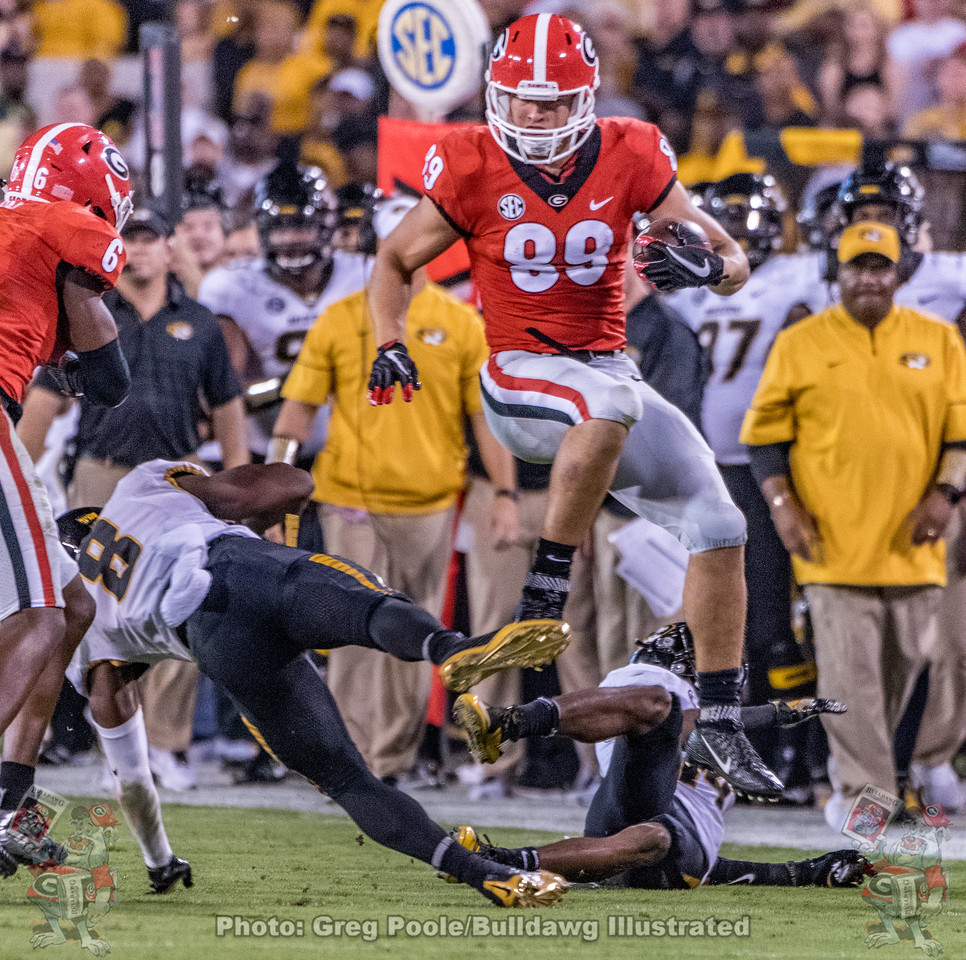 UGA tight end, Charlie Woerner (89), hurdles Mizzou players during the 2017 Georgia vs. Missouri game in Athens, GA.