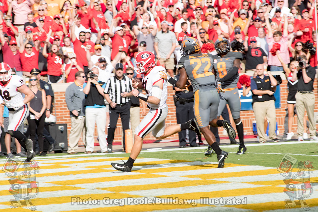 Jake Fromm (11) with one of two rushing touchdowns in the second quarter versus Tennessee in Knoxville, Saturday, September 30, 2017