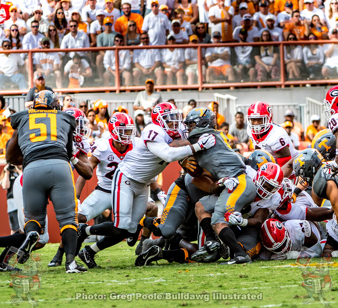 Georgia defense stuffs Volunteer ball carrier during the 2017 Tennessee game in Knoxville