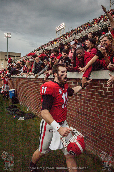 Jake Fromm (11) celebrates with Dawg fans at Bobby Dodd Stadium after Georgia defeats the Yellow Jackets 38-7 on Saturday, November 25, 2017