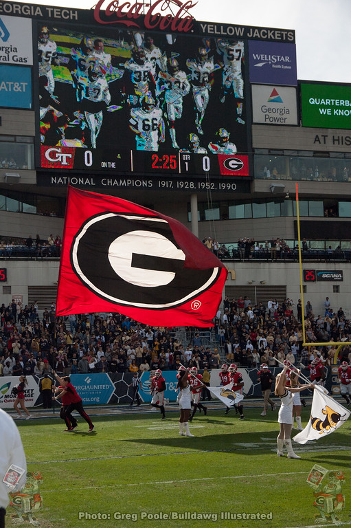 """The Georgia """"G"""" flies across the field of Bobby Dodd Stadium as the Bulldogs prepare to take on the Yellow Jackets on Saturday, November 25, 2017"""