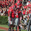 Demetris Robertson (16) and Trey Hill (55) celebrating Isaac Nauta's score