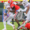 Monty Rice (32) causes a fumble