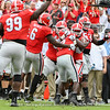 The defense celebrate with Richard LeCounte (2)