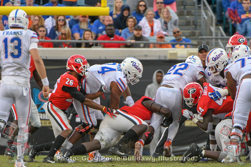 Georgia's defense attempts to stop Florida's rush attack.