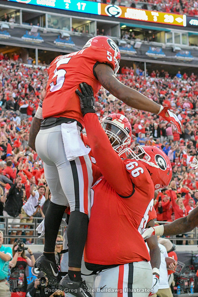 Terry Godwin (5)and Solomon Kindley (66)
