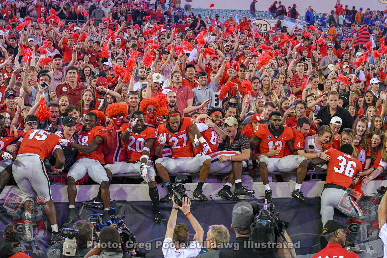 D'Andre Walker (15), Deandre Baker (18), J.R. Reed (20), Eric Stokes (27), Tyler Simmons (87), Elijah Holyfield (13) and Latravious Brini (36) celebrate with Dawg fans at TIAA Field after Georgia defeats Florida on 36-17 on Saturday, October 17, 2018