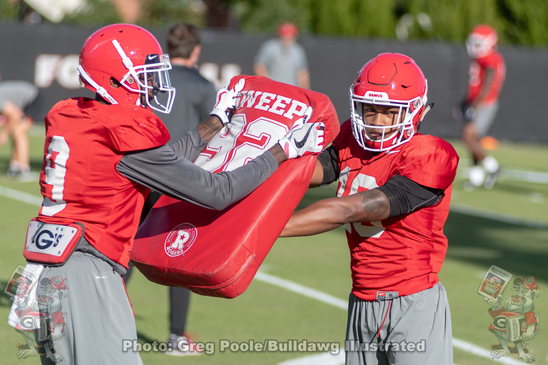 Jeremiah Holloman (9) and Demetris Robertson (16)