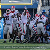 Devonte Wyatt (95) celebrates a fumble recovery