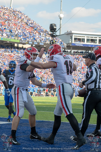 Jake Fromm (11) celebrate with Isaac Nauta (18)