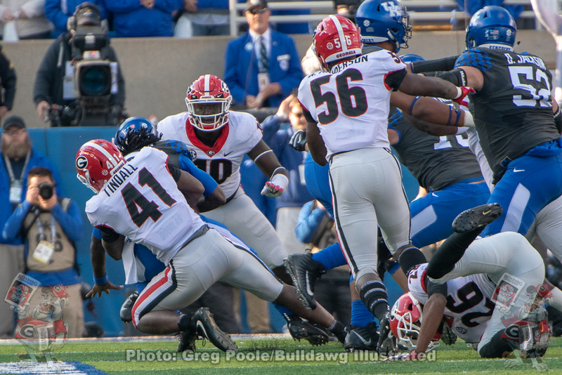 Channing Tindall (41) with the tackle