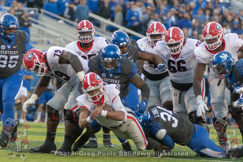 "Justin Fields (1) and his ""wall"" as he gets the first down."