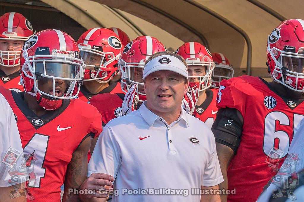 Mecole Hardman (04), Kirby Smart and Kendall Baker (65)