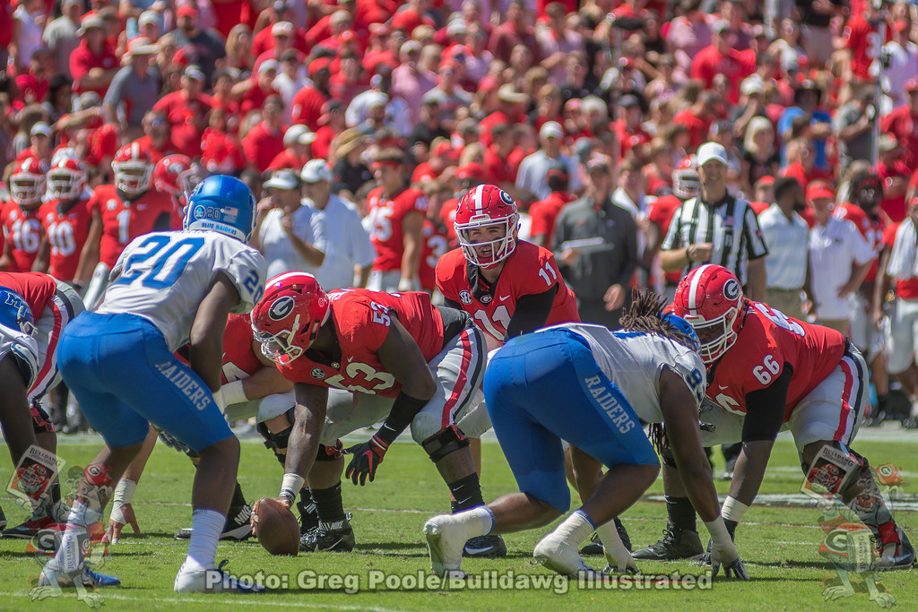 Lamont Gaillard (53) hikes the ball to Jake Fromm (11).