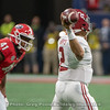 Channing Tindall (41) eyes Jalen Hurts