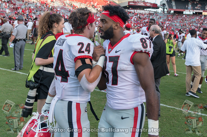 Prather Hudson (24) and Tyler Simmons (87)