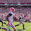 Deandre Baker (18) races with an interception for a TD as Tyler Clark (52) begins the celebration