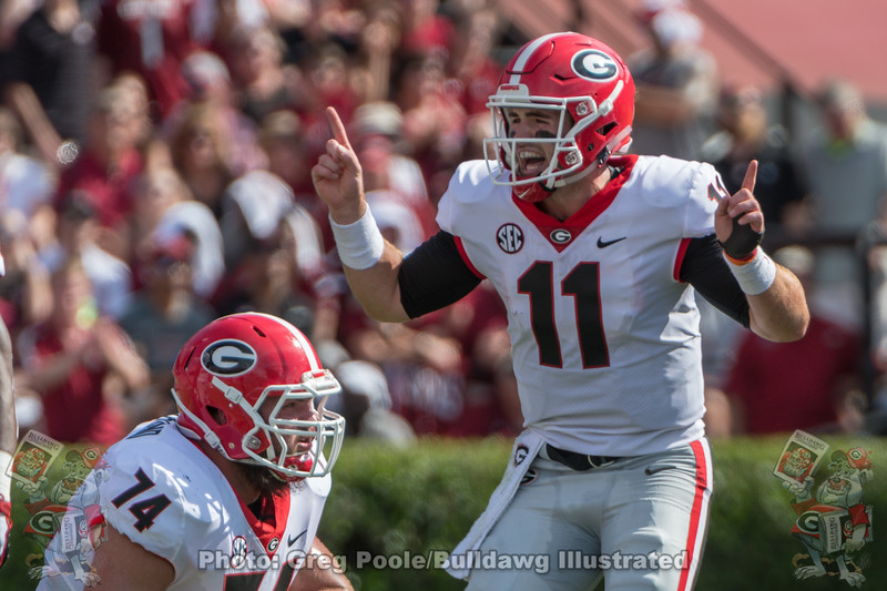 Jake Fromm (11) and Ben Cleveland (74)