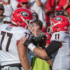 Cade Mays (77) and Jake Fromm (11)