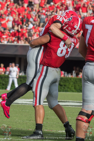 Rodrigo Blankenship (98) and Charlie Woerner (89) celebrate and extra point that just made it over the bar