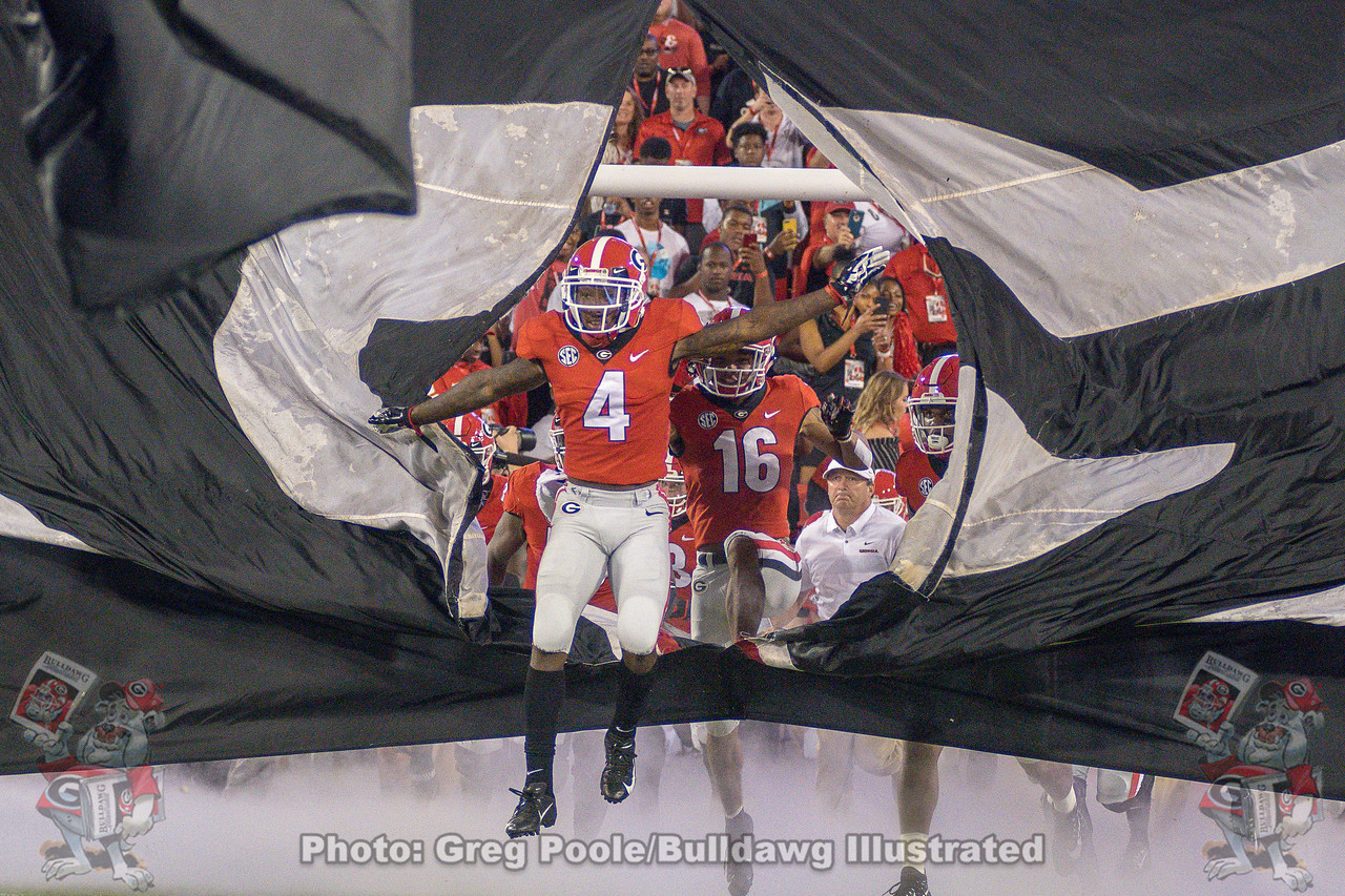 Mecole Hardman Jr. (4), breaks through the Georgia banner leading the Bulldogs onto the field for their homecoming game  versus Vanderbilt on October 6, 2018.