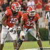 D'Andre Walker (15) and Monty Rice (32)
