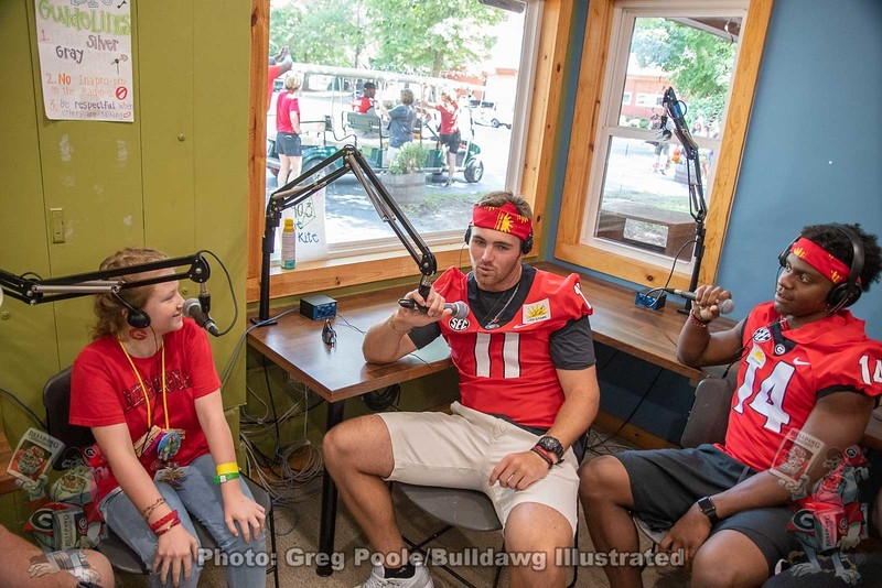Jake Fromm (11) and Trey Blount (14) talk with a camper on Camp Sunshine's own radio station.