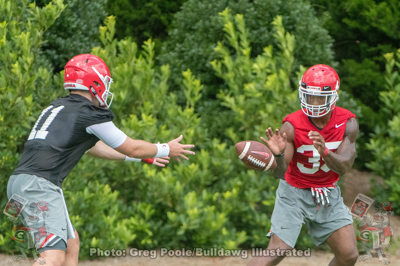 Jake Fromm pitches to Brian Herrien