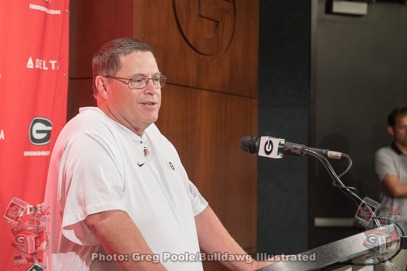 Jim Chaney answers a question from the beat media prior to fan day practice.