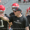 Coach James Coley gives instruction to Jake Fromm (11)