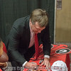 Kirby Smart autographs a hat for a young fan - Anderson Area Touchdown Club Annual Awards Banquet - February 28, 2018