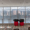 """These windows by the patio have switchable fogging to prevent recruits and their families from having """"premium seating"""" (an NCAA requirement). The temporary bleachers outside also help downgrade the view."""