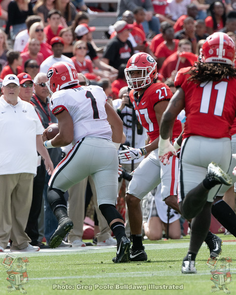 Justin Fields (1) , Eric Stokes (27) and Keyon Brown (11)