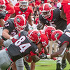 Brian Herrien (35) tackles by Walter Grant (84) and Juwan Taylor (44)