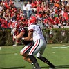 Justin Fields (1) hands off to Prather Hudson