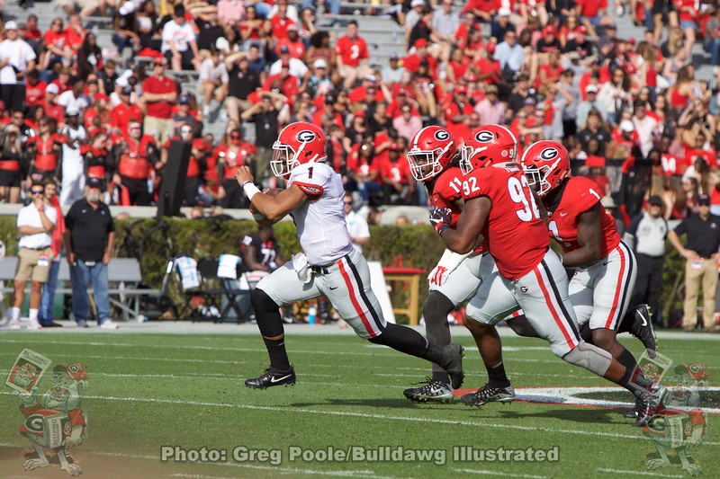 Justin Fields tucks the ball and makes a play with his legs.