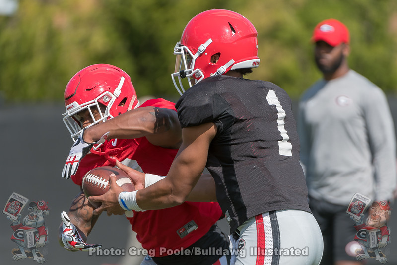 Elijah Holyfield (13) and Justin Fields (1)