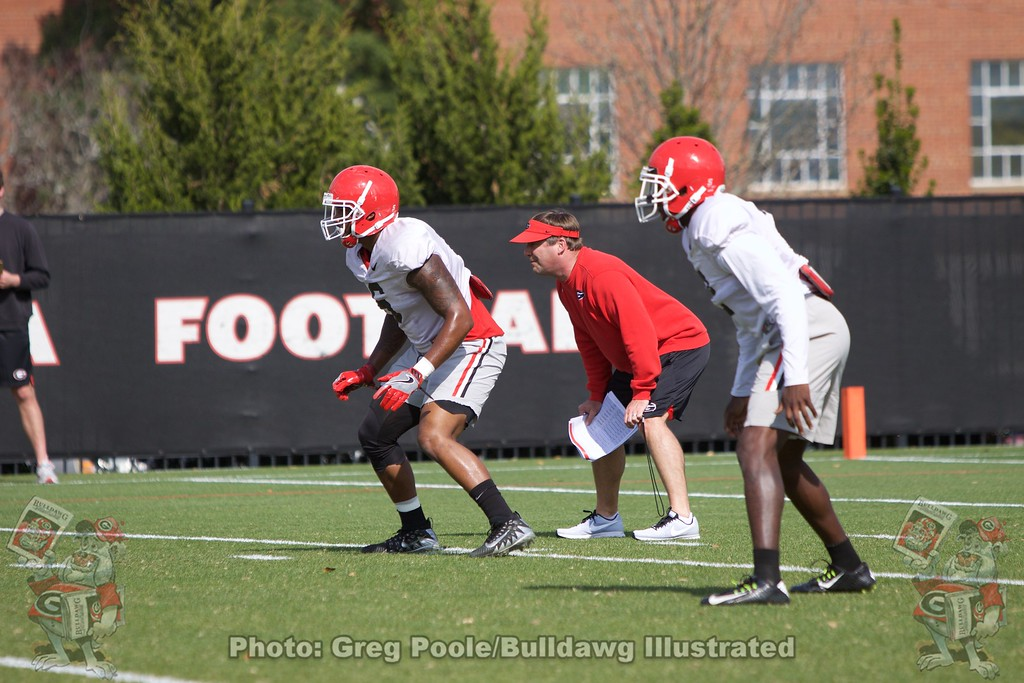 Natrez Patrick (6) and Kirby Smart run through a drill.