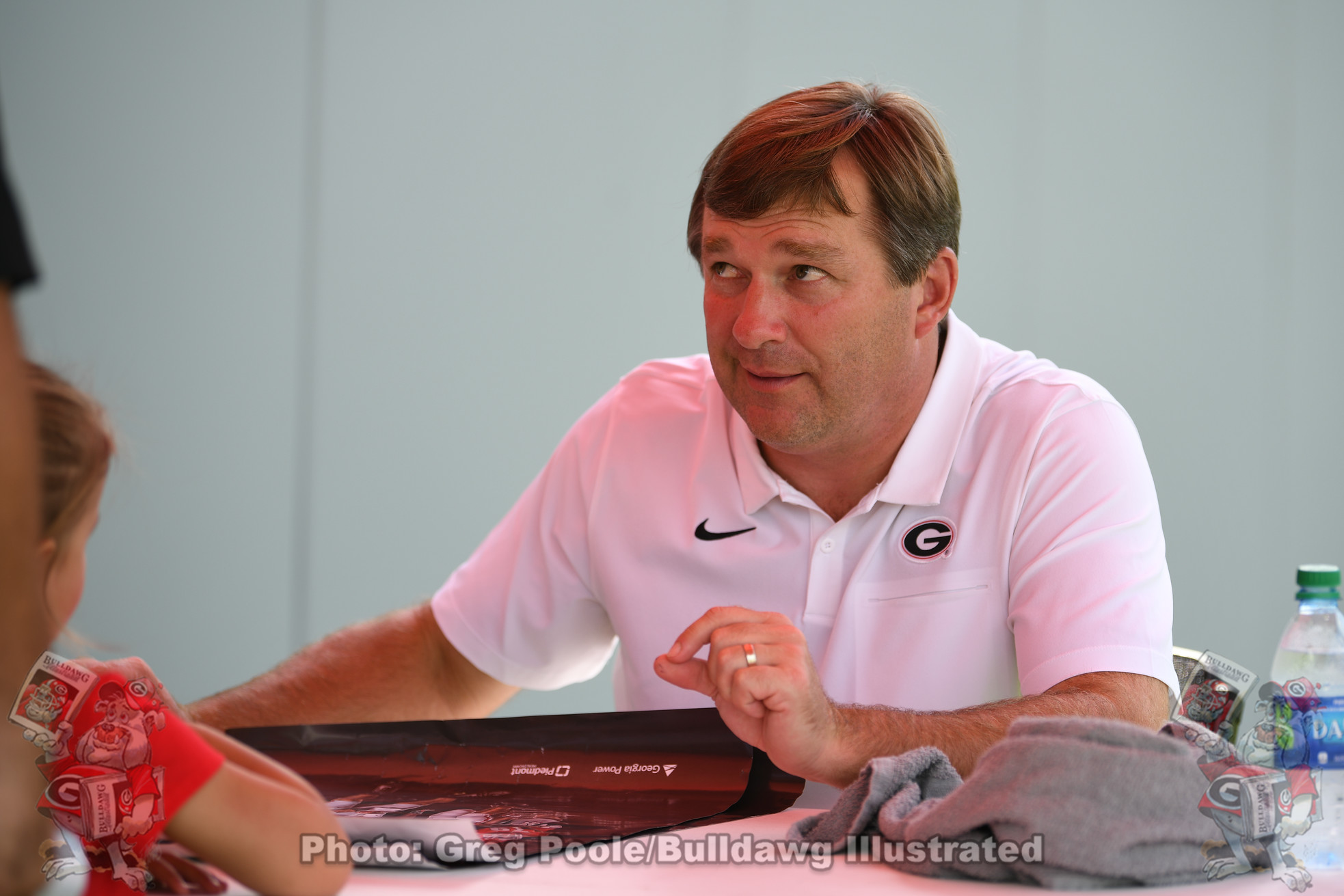 Kirby Smart signing autographs