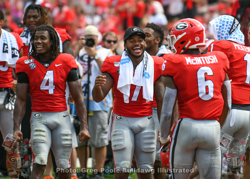 James Cook (4) and D'Andre Swift (7) greet Kenny McIntosh (6) after his TD