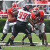 Ben Cleveland (74) block for Zamir White (3)