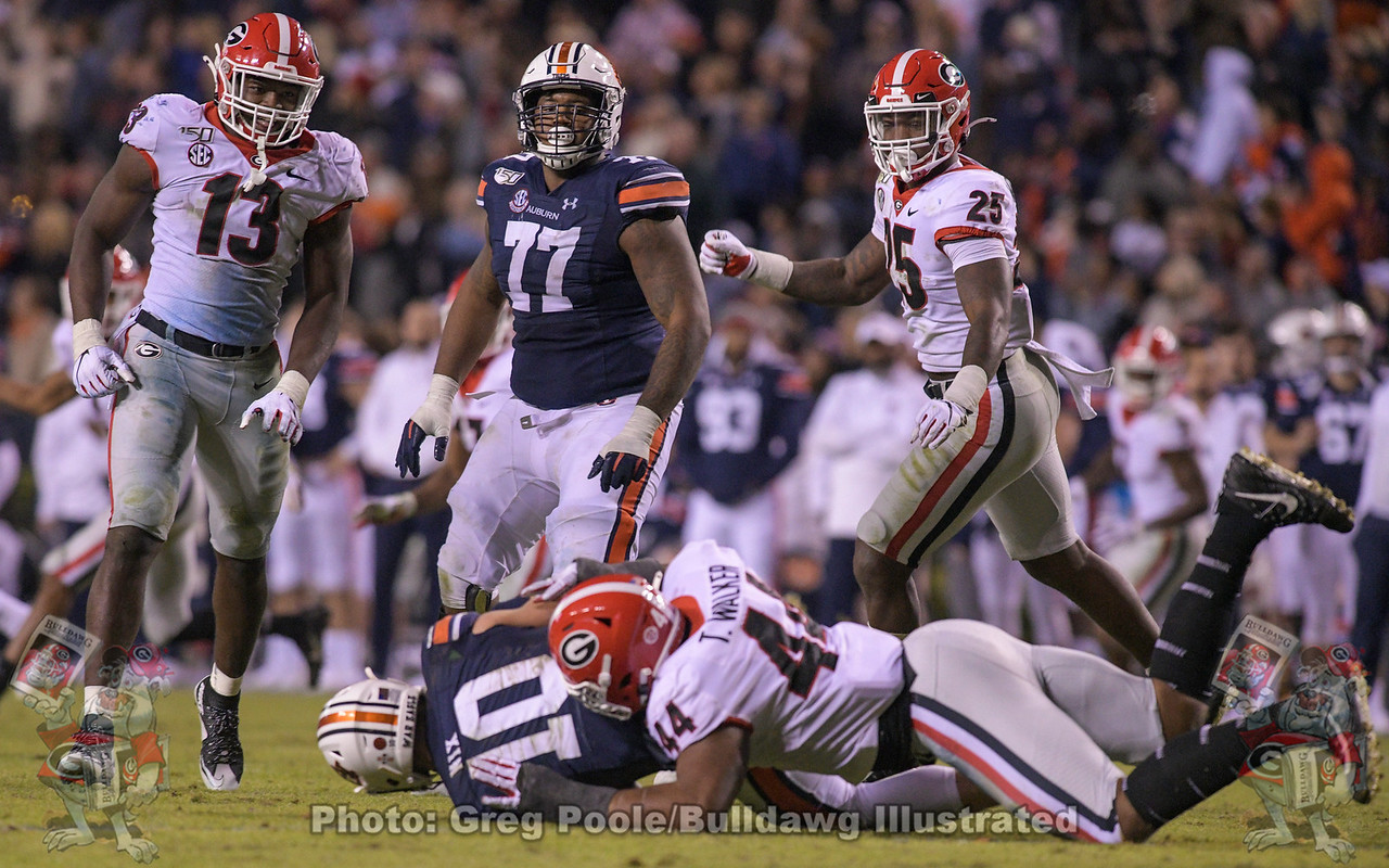 UGA's Travon Walker (44) with the sack on Tiger QB Bo Nix (10) during the fourth quarter of the Georgia vs. Auburn game on Saturday, November 16, 2019