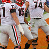 Cade Mays (77), Lawrence Cager (15) and Ben Cleveland (74)
