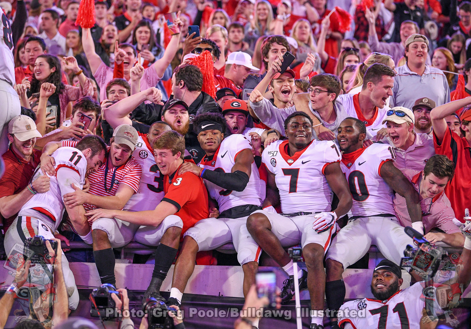 (L-R) Jake Fromm (11), Zamir White (3), Tyson Campbell (3), Tyrique Stevenson (7), Kearis Jackson (10), along with a number of their teammates celebrate with Dawg fans after Georgia defeats Florida 24-7, Saturday, November 2, 2019
