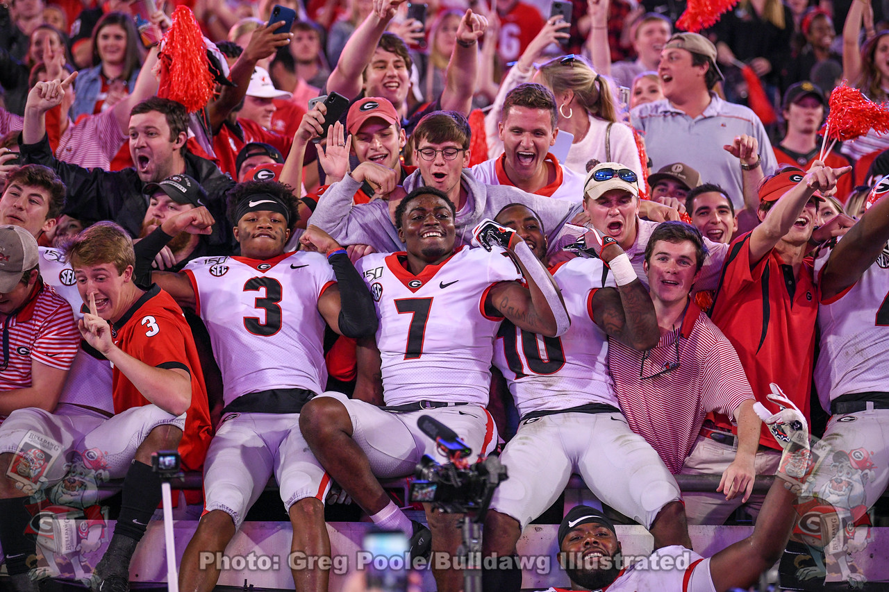 Tyson Campbell (3) celebrates with fans and teammates after Georgia upends Florida 24-17 on Saturday, November 2, 2019, in Jacksonville