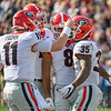 Jake Fromm (11) and Brian Herrien (35)