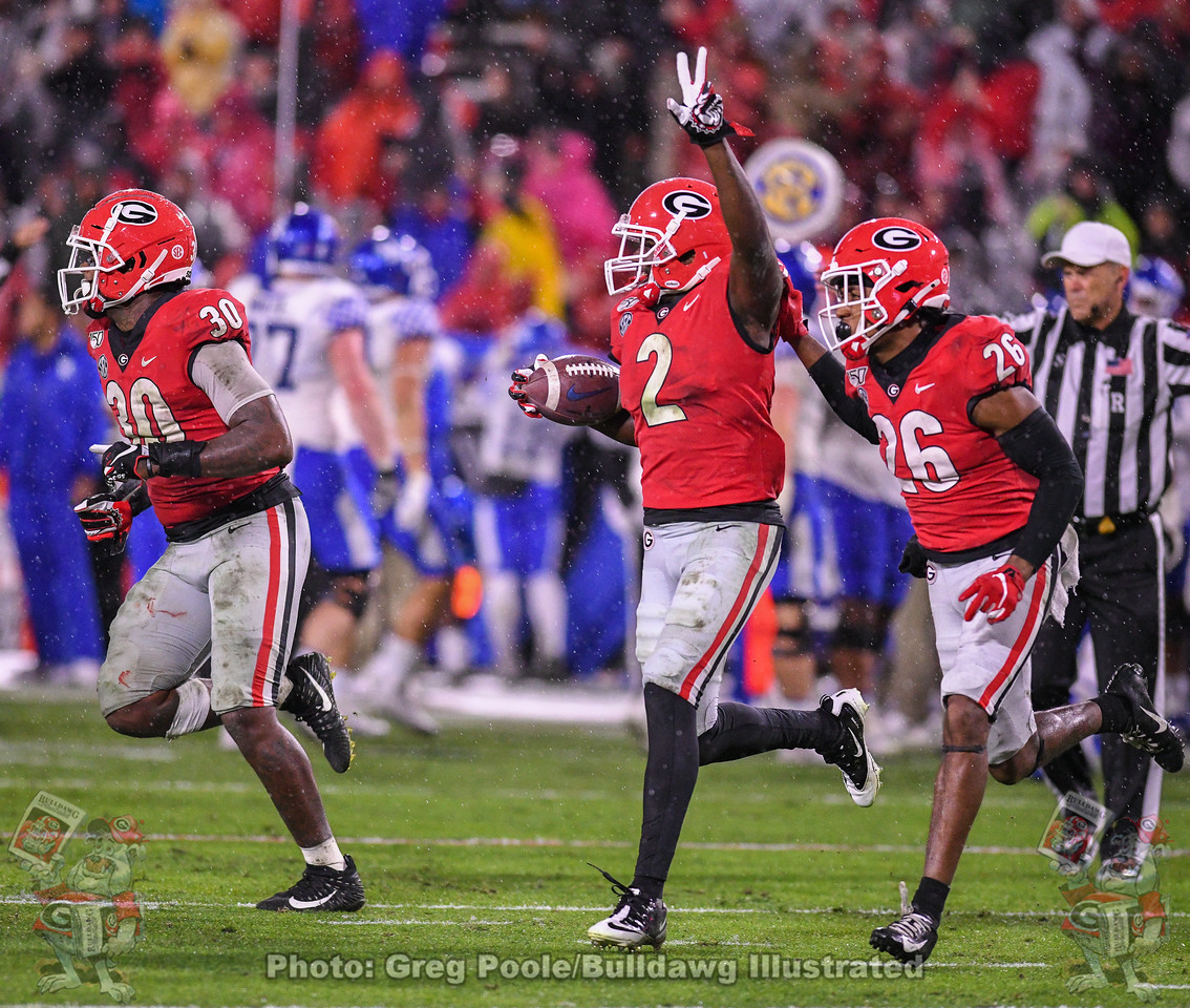 Tae Crowder (30), Richard LeCounte (2), and Tyrique McGhee (26) celebrate as they head to the sideline after LeCounte recovers a Wildcat fumble in the third quarter of the Kentucky game on Saturday, October 19, 2019