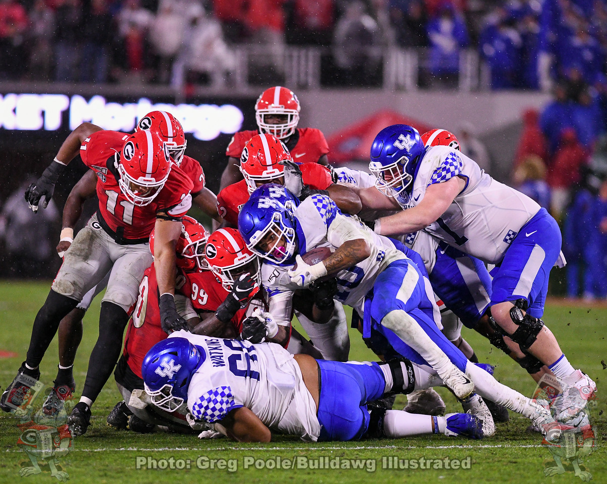 Jermaine Johnson (11) and Jordan Davis (99) stuff the Wildcat ball carrier during the third quarter of the Kentucky game on Saturday, October 19, 2019