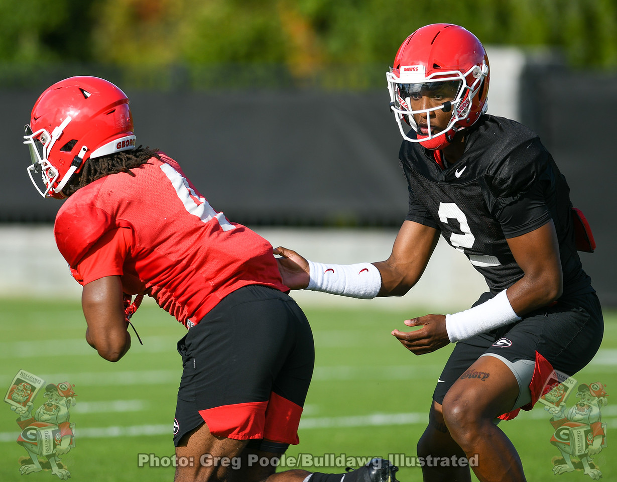 D'Wan Mathis (2) hands the ball off to James Cook (4) during Monday's practice, October 14, 2019